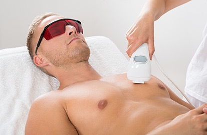 Chest men hair removal being completed at The Naked Truth Laser Skin Clinic