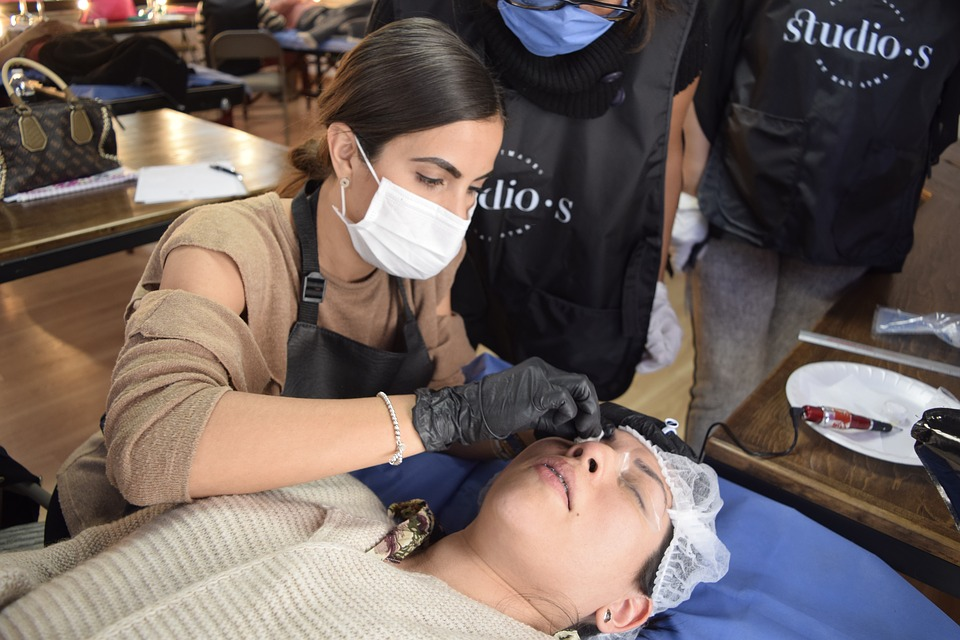 a client partaking in microblading from a technician