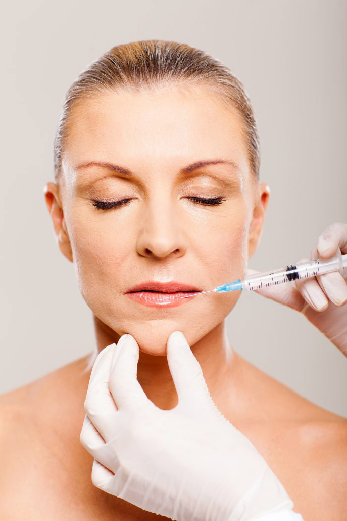 botox injection being done to a mature women